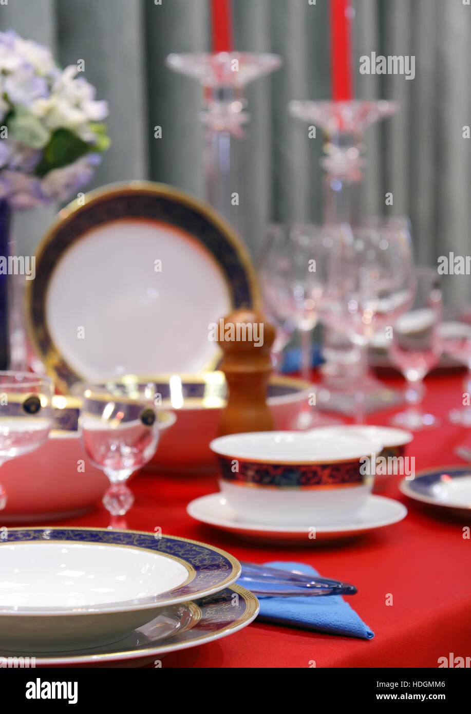 Table appointments on red tablecloth.Accent focus on front. - Stock Image