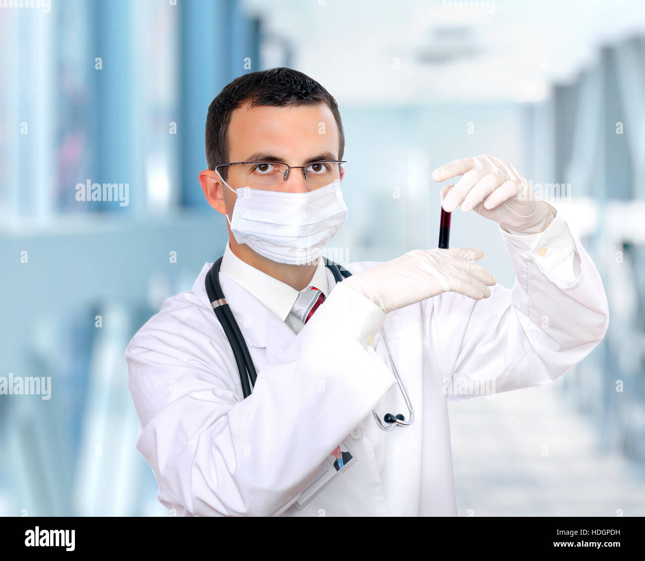 Doctor  resarch a medical test glass with blood in Hospital. - Stock Image