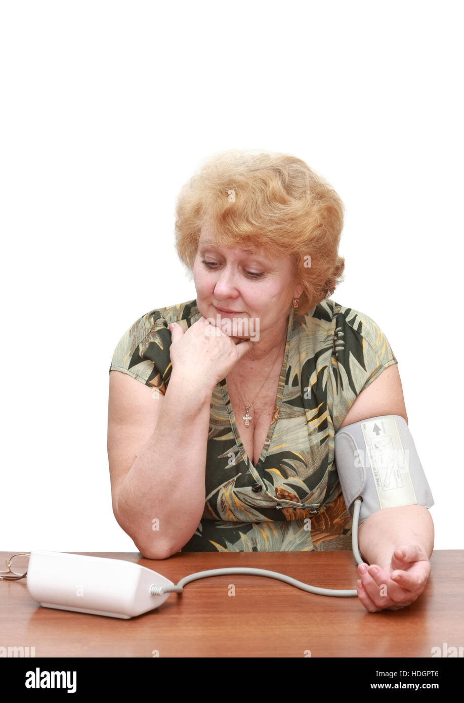 Senior lady measures arterial pressure , use digital tonometer . Isolated. Happy by instrument readings. - Stock Image