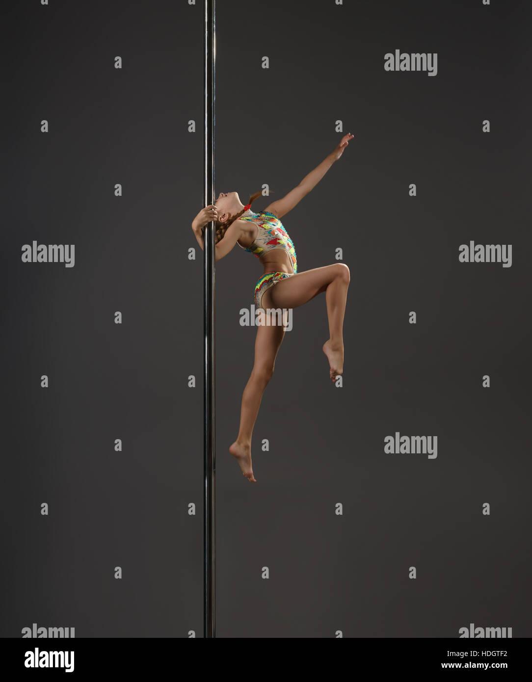 Girl making exercises on pilon stidio shot - Stock Image