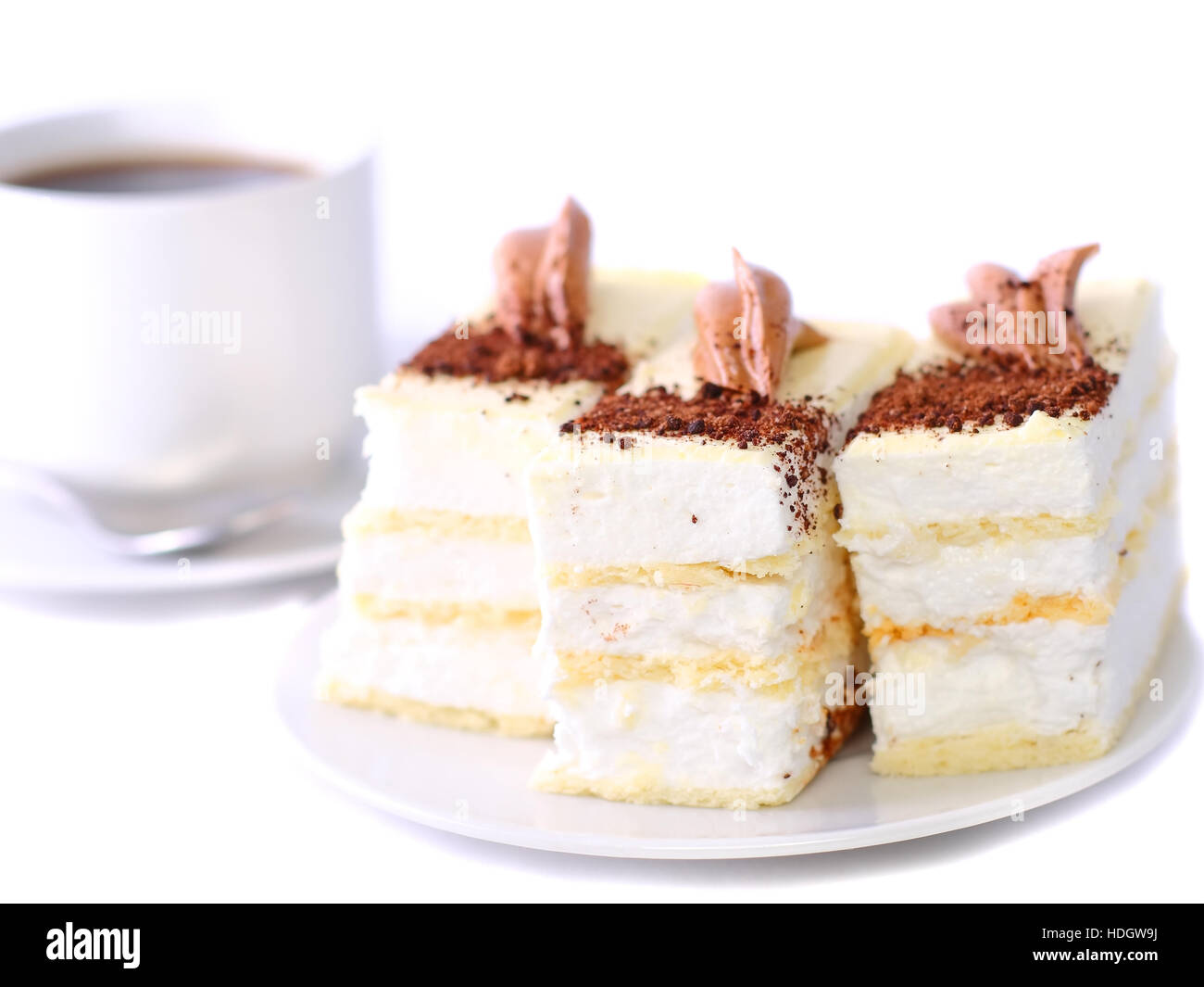 Sponge cakes with cup of coffee on plate with fruit-juice decoration . Isolated - Stock Image