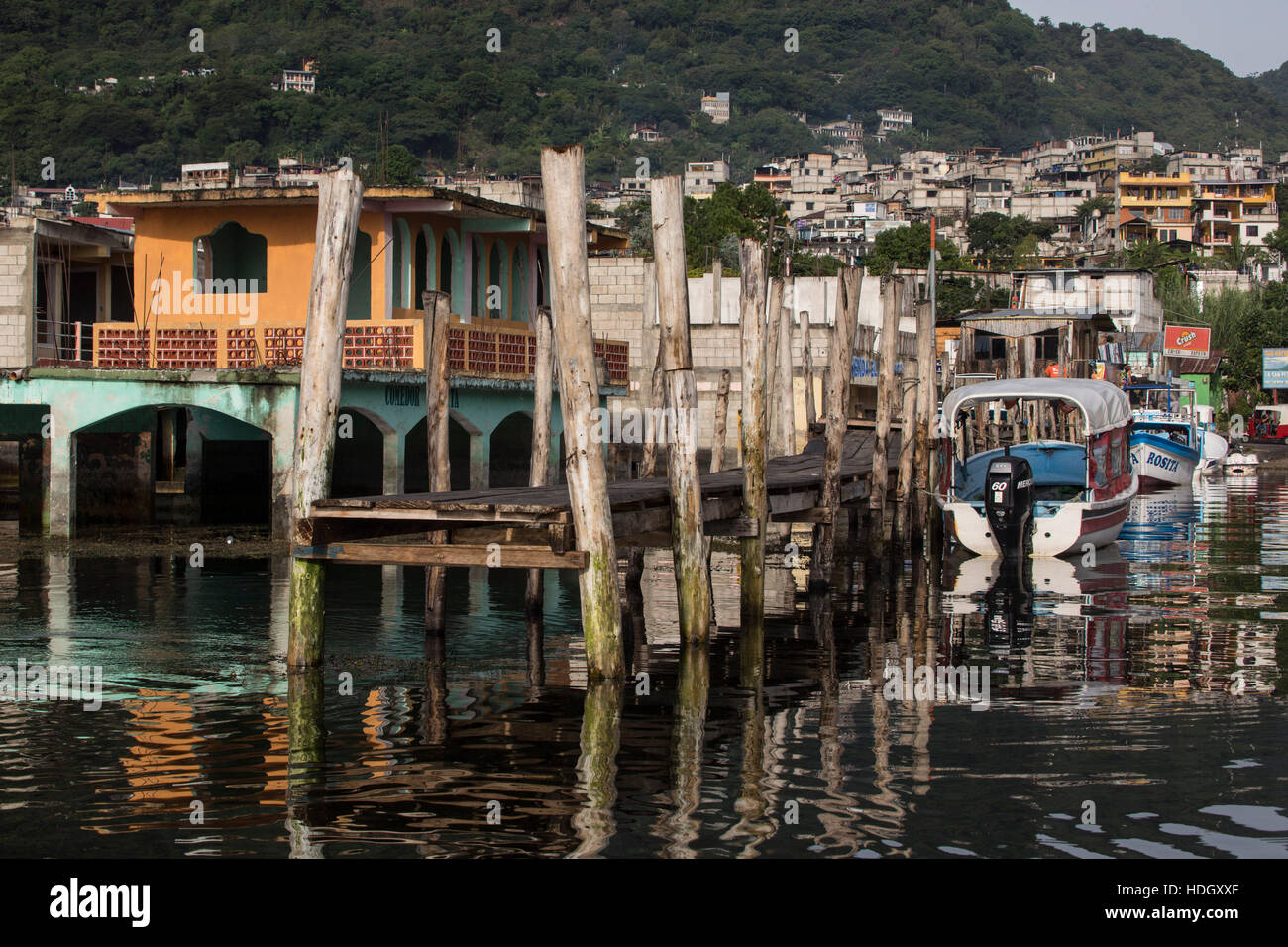 Since 2009 Lake Atitlan in Guatemala has risen more than 30 feet, flooding farmlands and shoreline buildings of - Stock Image