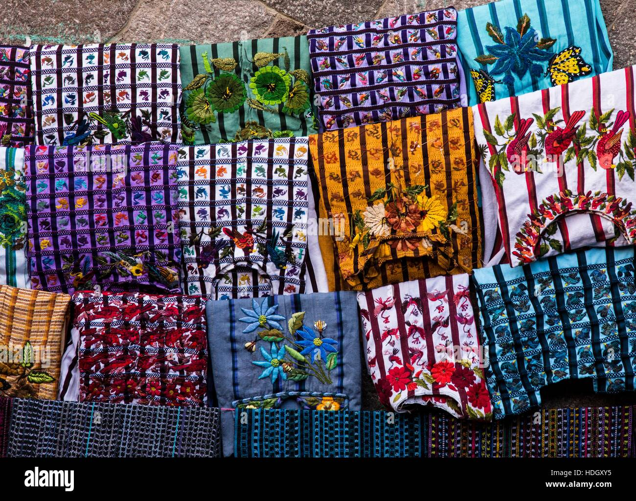Used huipil blouses for sale in the open market in Santiago Atitlan, Guatemala.  The huipils are hand woven and - Stock Image