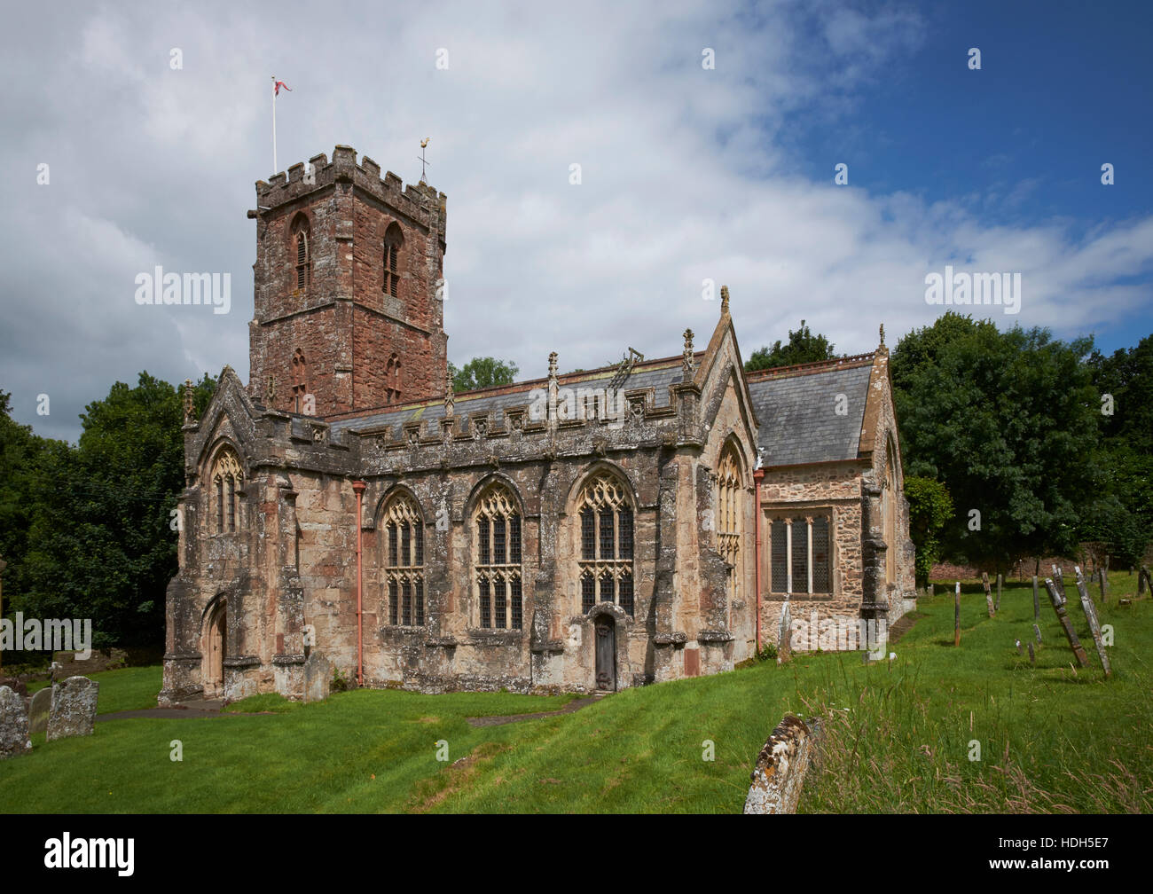The Church of the Holy Ghost, Crowcombe, Somerset.  Late Gothic, view from the south, red sandstone - Stock Image