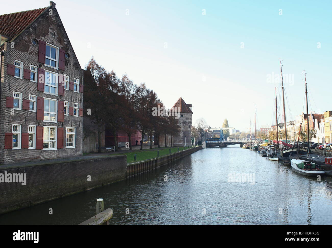 Medieval warehouses at Thorbeckegracht / Thorbecke canal, Zwolle, Netherlands. Ramparts & old city wall with - Stock Image