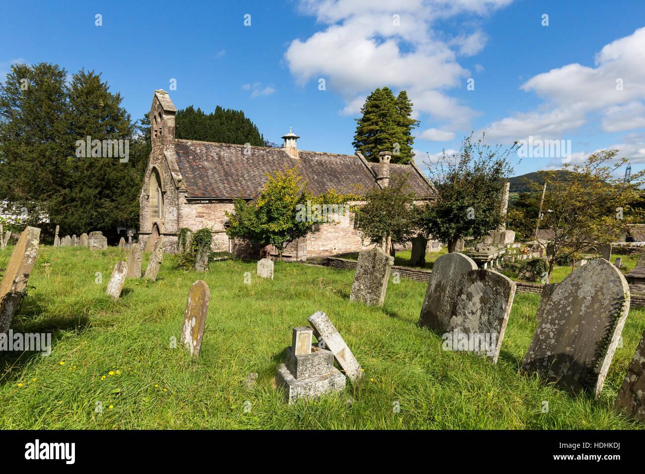 Churchyard with leaning gravestones, Llanfoist, Wales, UK - Stock Image