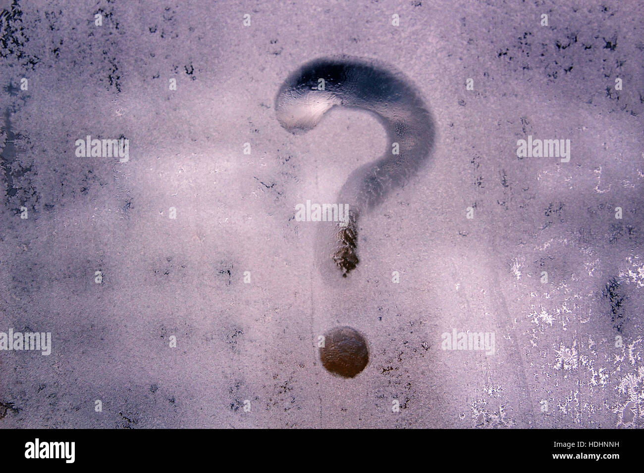 The question mark on frosted glass window - Stock Image