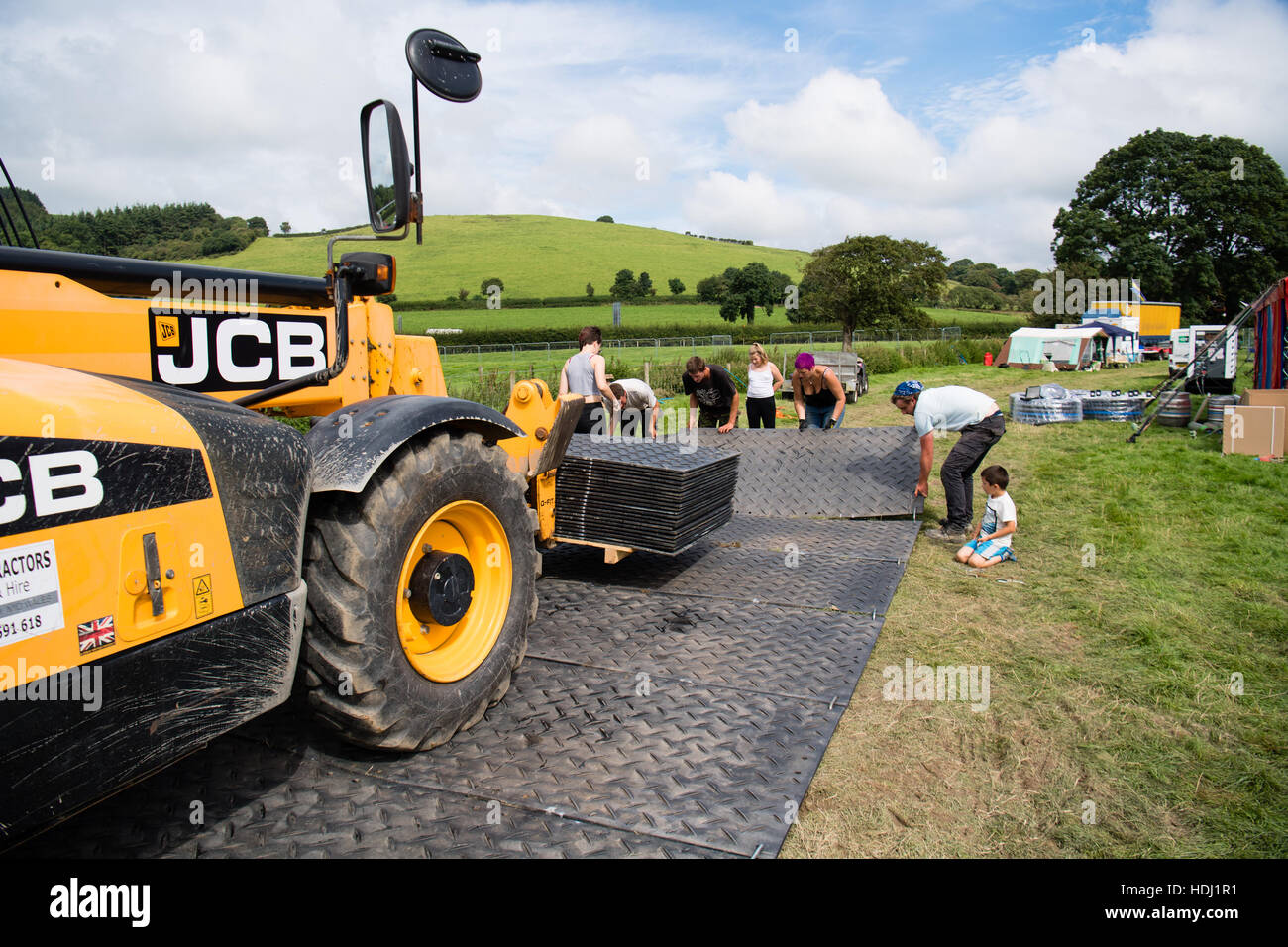 Behind the scenes: Contractors laying the all-weather trackway for the 2016 Big Tribute music festival, on the outskirts - Stock Image