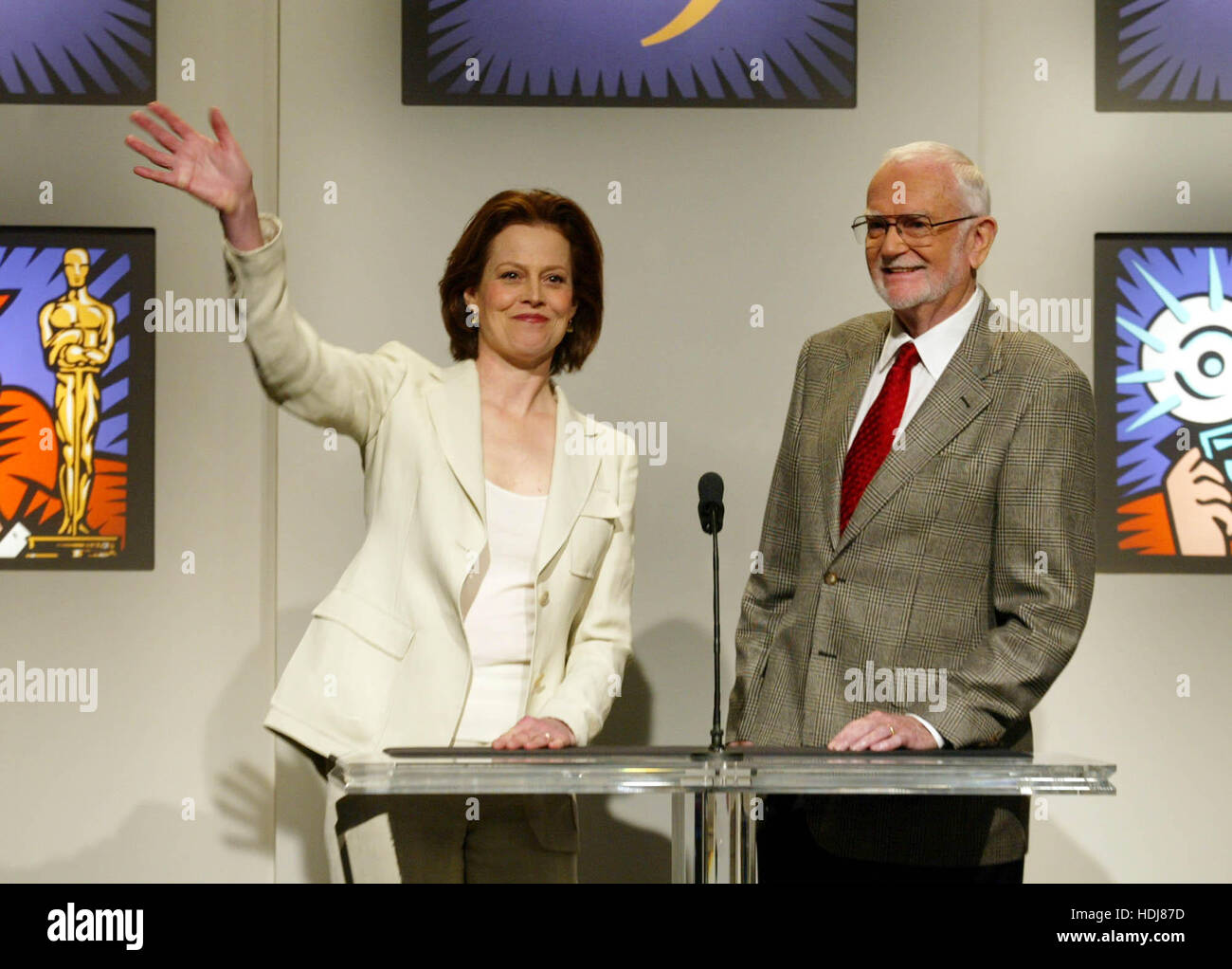 Actress Sigourney Weaver  waves and Frank Pierson, president of the Academy of Motion Picture Arts and Science, - Stock Image