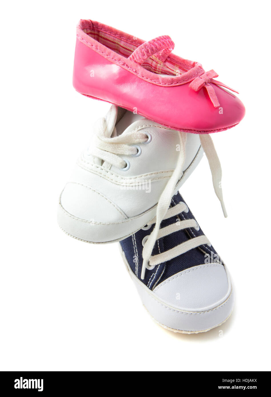 Baby shoes on a pile isolated over white - Stock Image