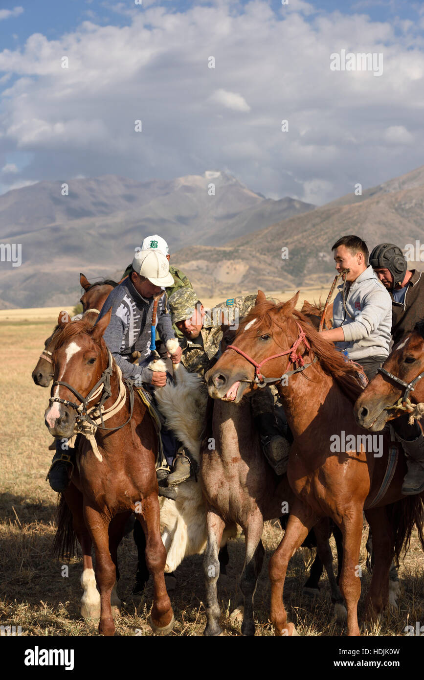 Horse riders in melee pulling and grabing goat carcass in game of Kokpar Tudabarai in Aksu Zhabagly Kazakhstan Stock Photo
