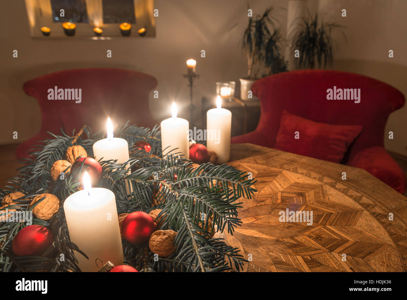 Advent candles with decorated fir tree on a ancient table - Stock Image