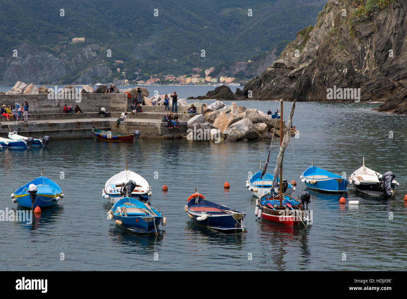 Boats in the tiny harbor of Vernazza - one of the Cinque Terre, Liguria, Italy - Stock Image