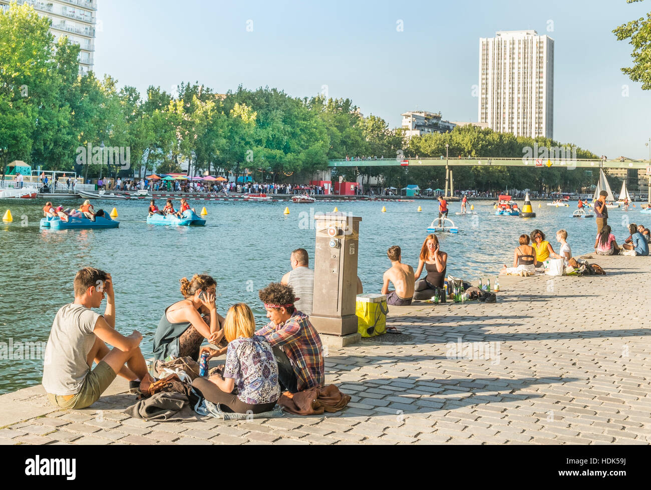 young people on the banks of river seine during paris plage in summer - Stock Image