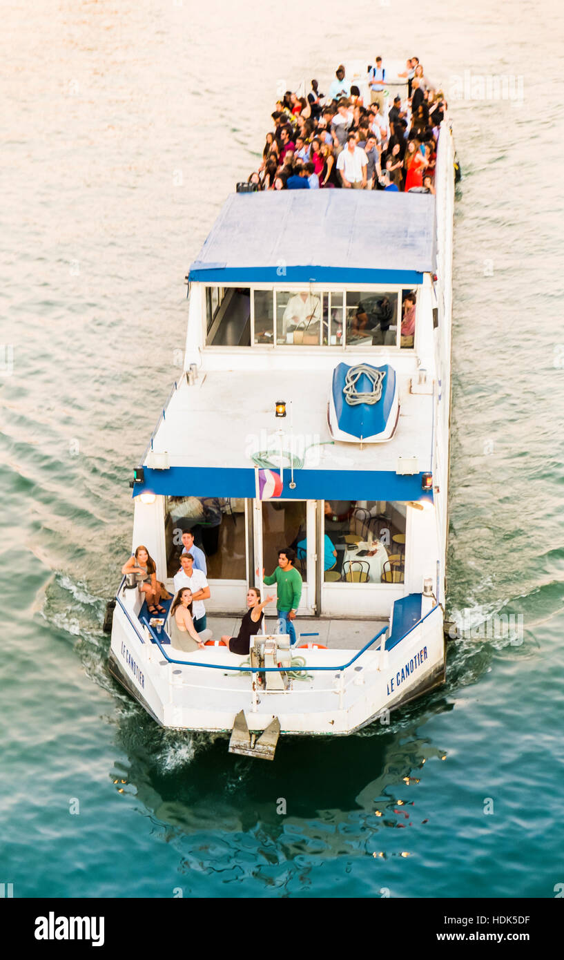 young people partying on a boat on river seine - Stock Image
