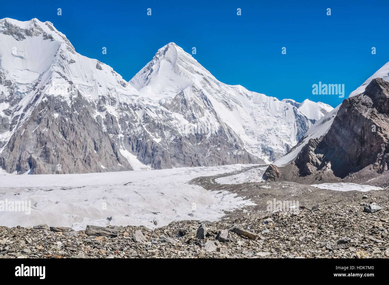 Photo of rocky mountains with snowy tops near South Inylcheck Glaciar in Kyrgystan. - Stock Image