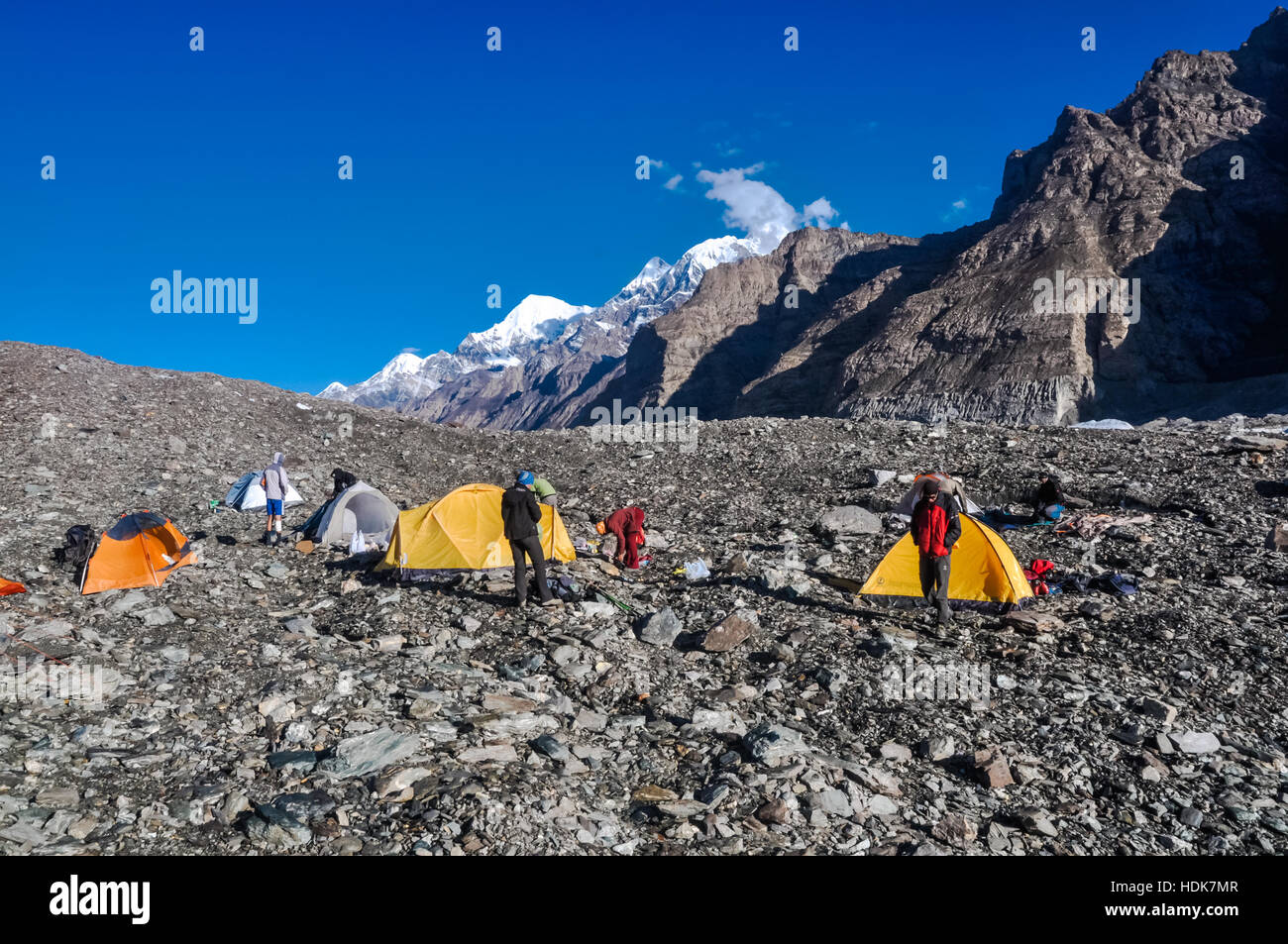 Photo of tents of hikers on rocks near South Inylcheck Glaciar in Kyrgystan. - Stock Image