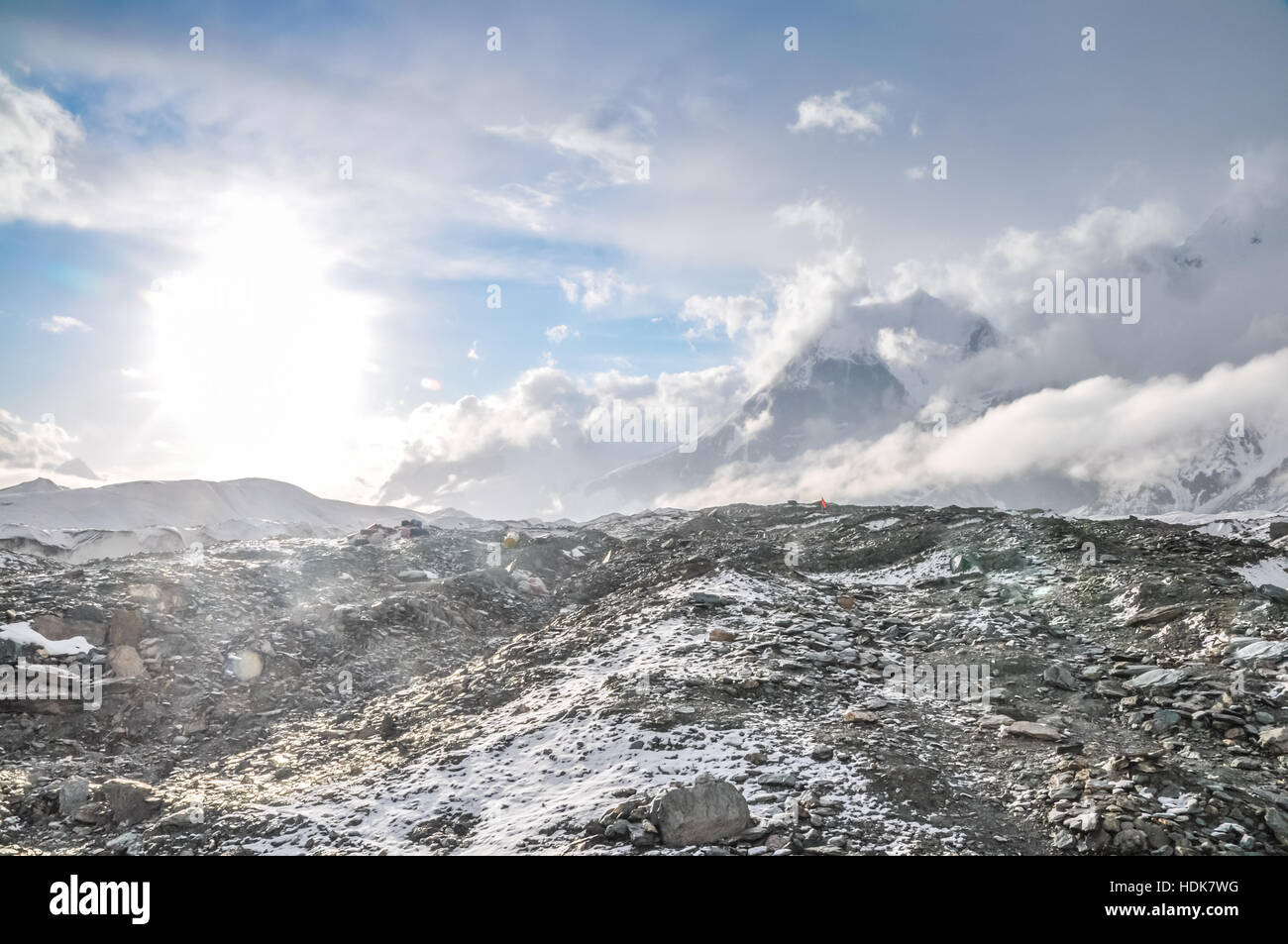 Photo of rocky terrain with fog in distance near South Inylcheck Glaciar in Kyrgystan. - Stock Image
