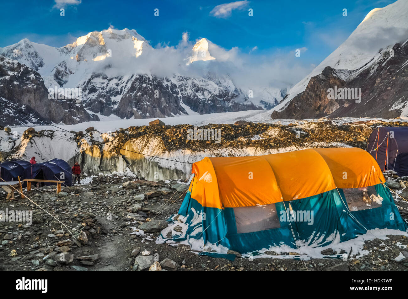 Photo of large tent of hiker on rocky ground near South Inylcheck Glaciar in Kyrgystan. - Stock Image