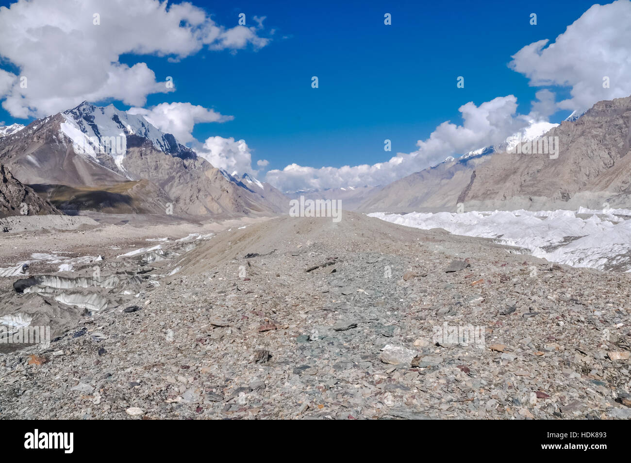 Photo of rocks and mountains with snowy tops near South Inylcheck Glaciar in Kyrgystan. - Stock Image