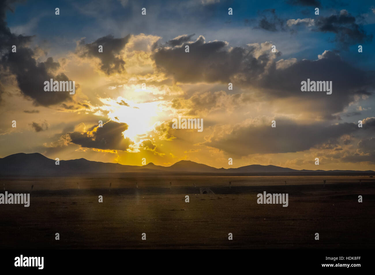 Photo of sunset on cloudy sky in Ala Archa National Park in Kyrgystan. - Stock Image