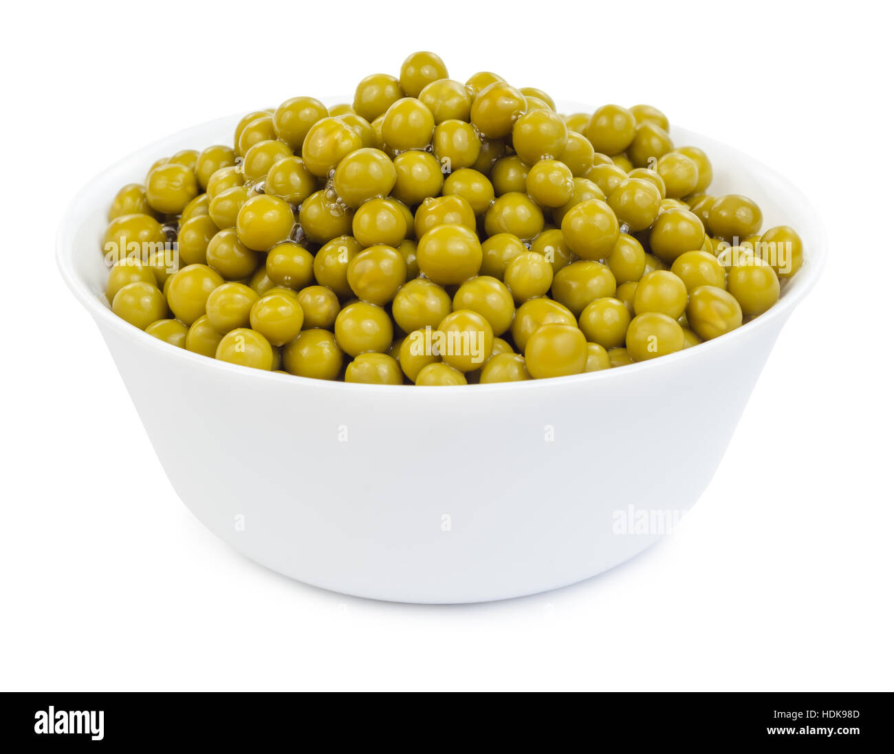Marinated green peas in bowl isolated on white background. - Stock Image