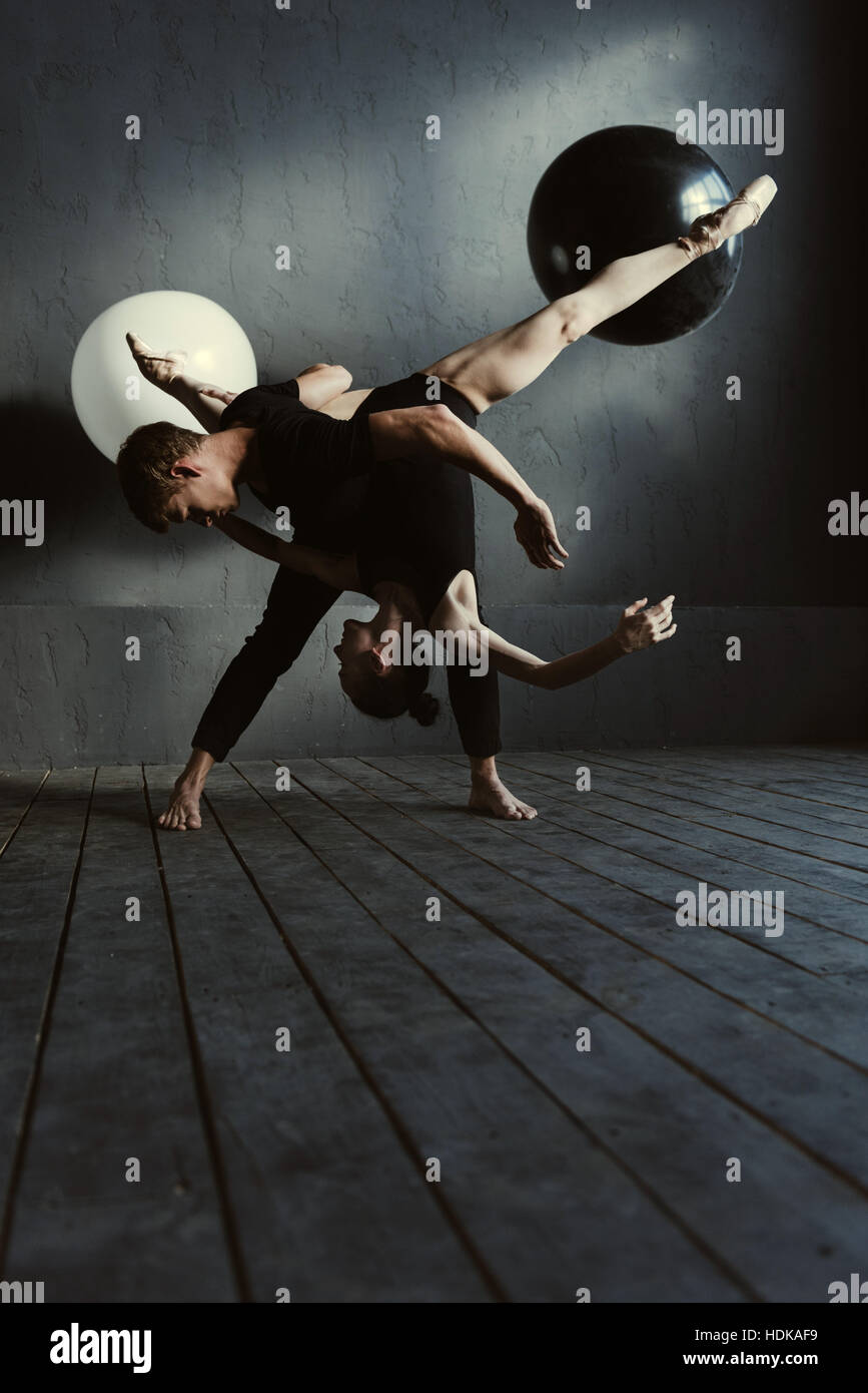 Gifted ballet dancers performing in the close interaction - Stock Image