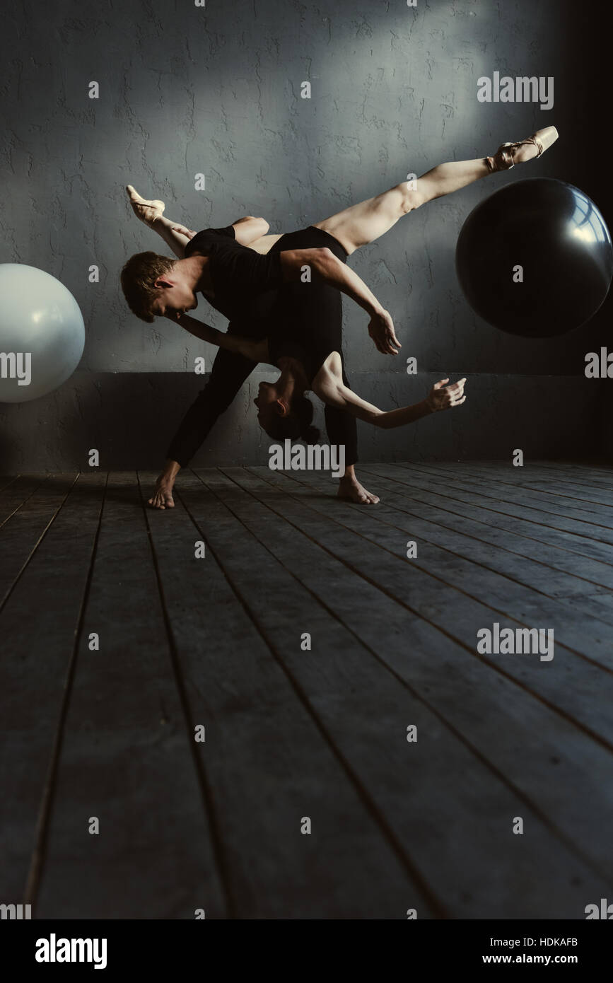 Flexible ballet dancers performing in the close interaction - Stock Image