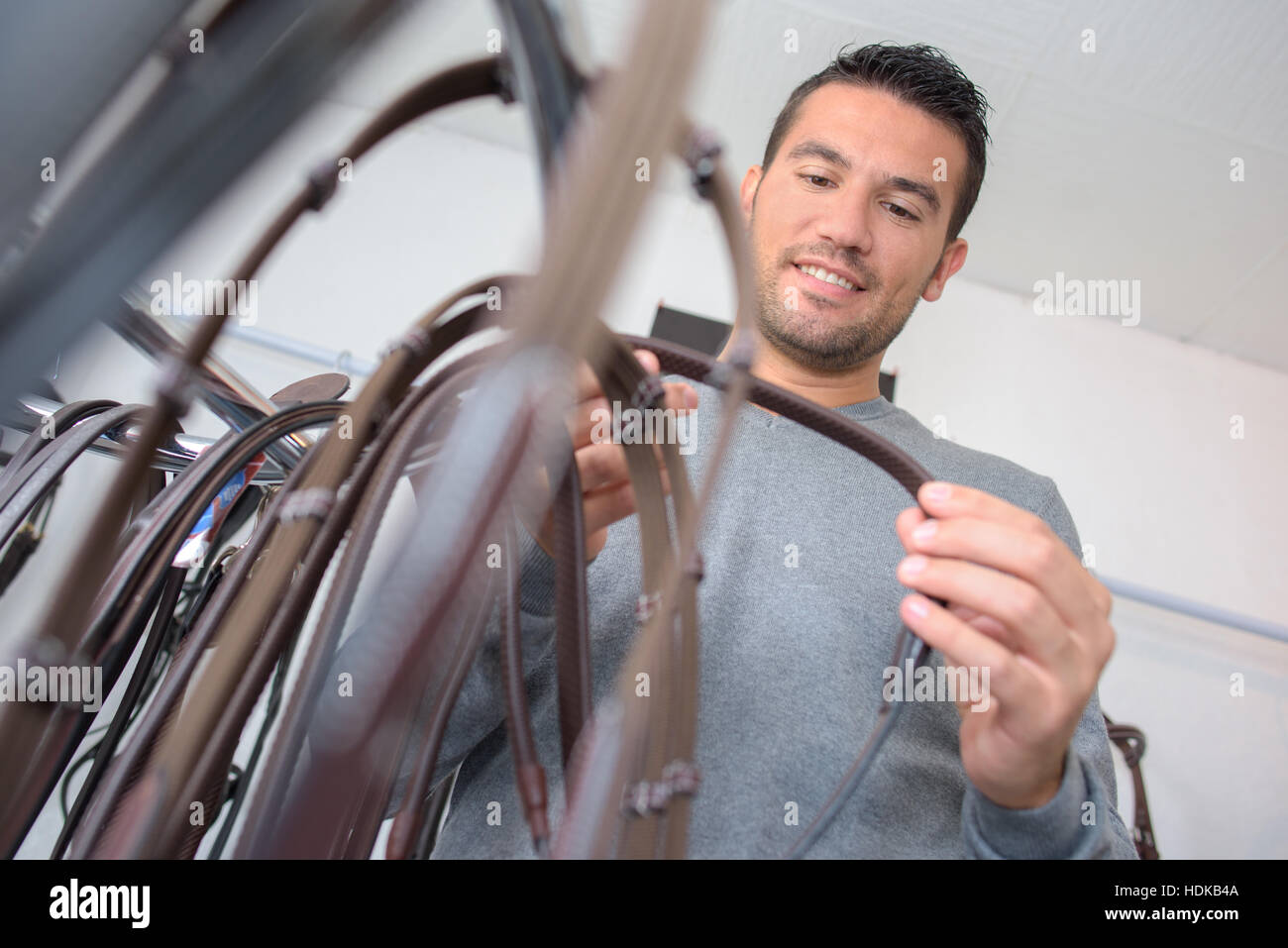 man buying bridle - Stock Image