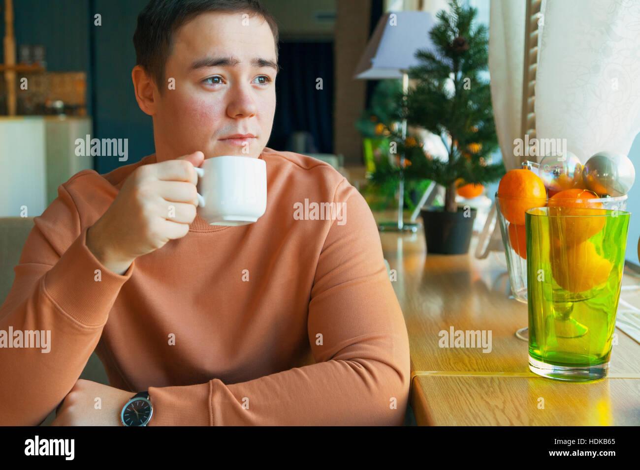 caucasian man in cafe - Stock Image