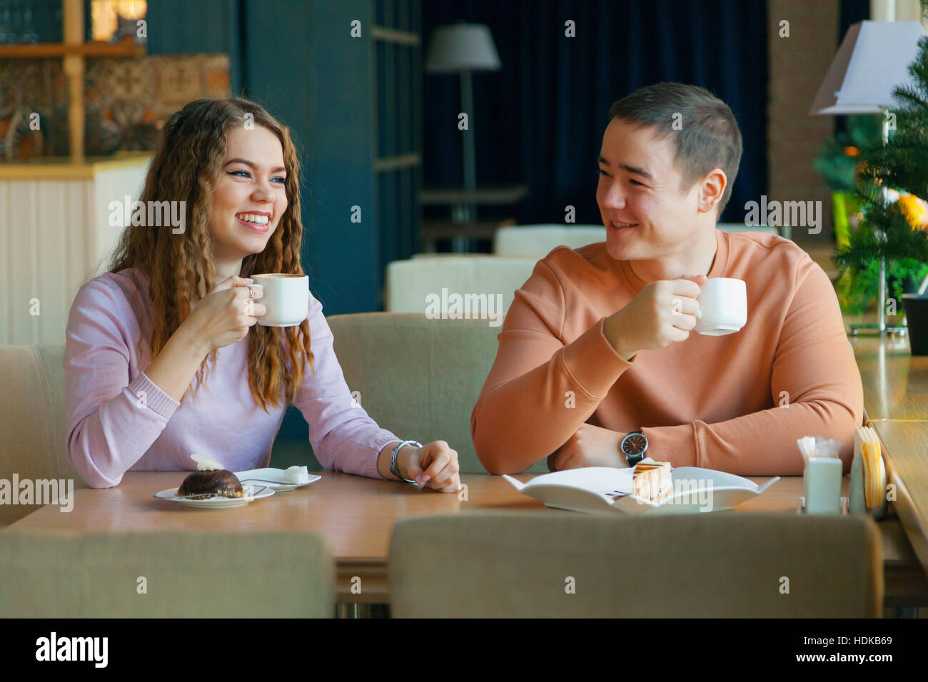 woman and a man in cafe - Stock Image