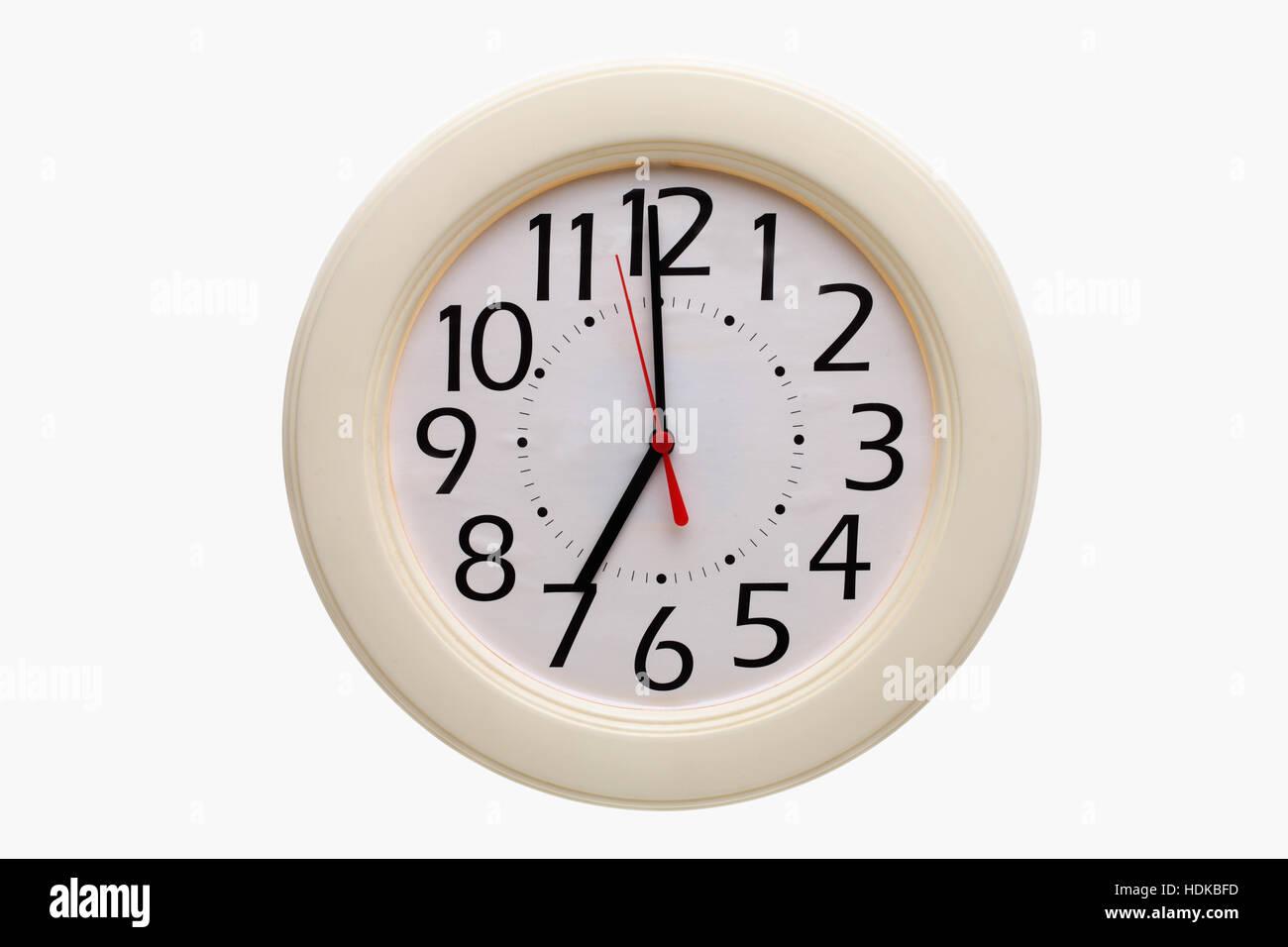 Analog wall clock 7:00 o'clock - Stock Image