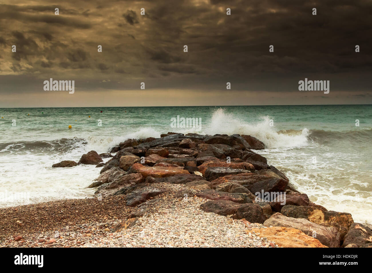 Storm over breakwaters of the beach. Horizontal image. - Stock Image