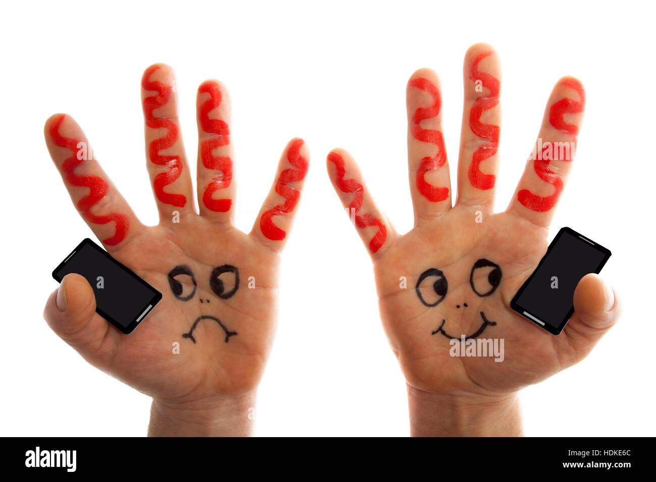Hands holding phones  and having a conversation - Stock Image