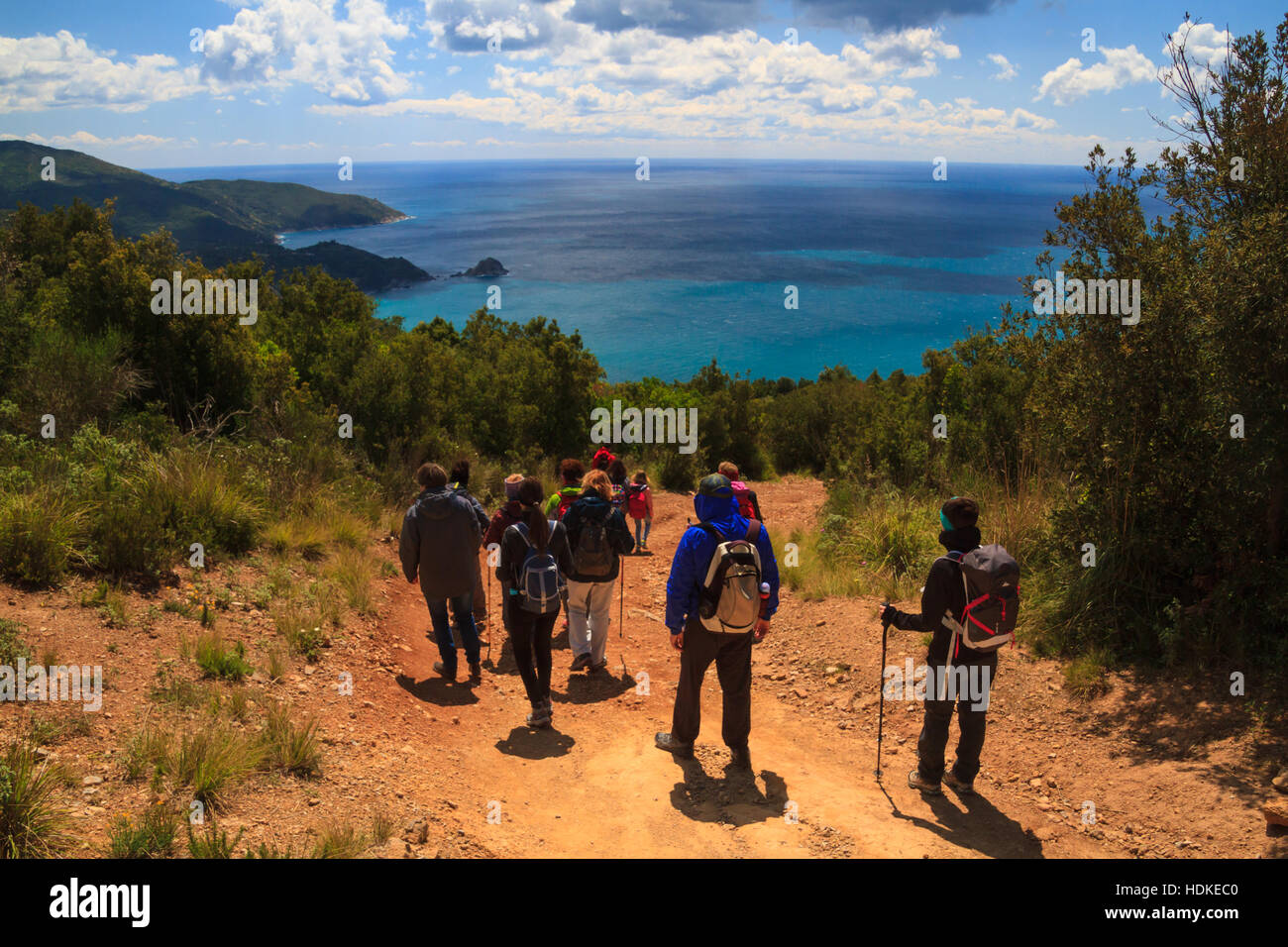 Monte Argentario, April 2016: Group of people trek in the Tuscan wild nature with seascape in a sunny day, on April - Stock Image