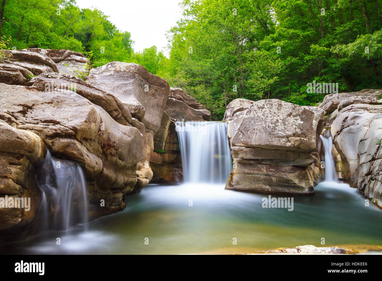 waterfall landscape with rocks and trees - Stock Image
