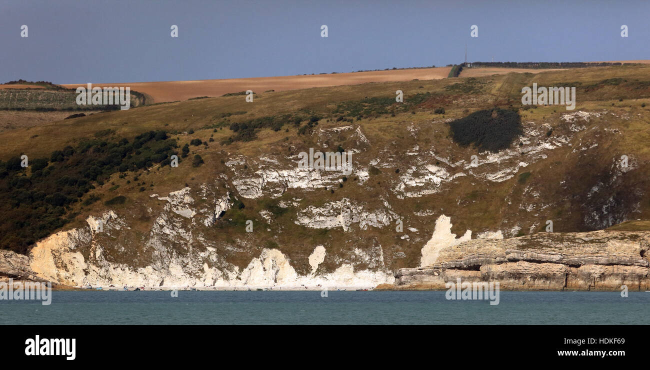 Mariner's angle into Lulworth Cove showing pincer rocks in limestone and the eroded cove rocks in softer chalk - Stock Image