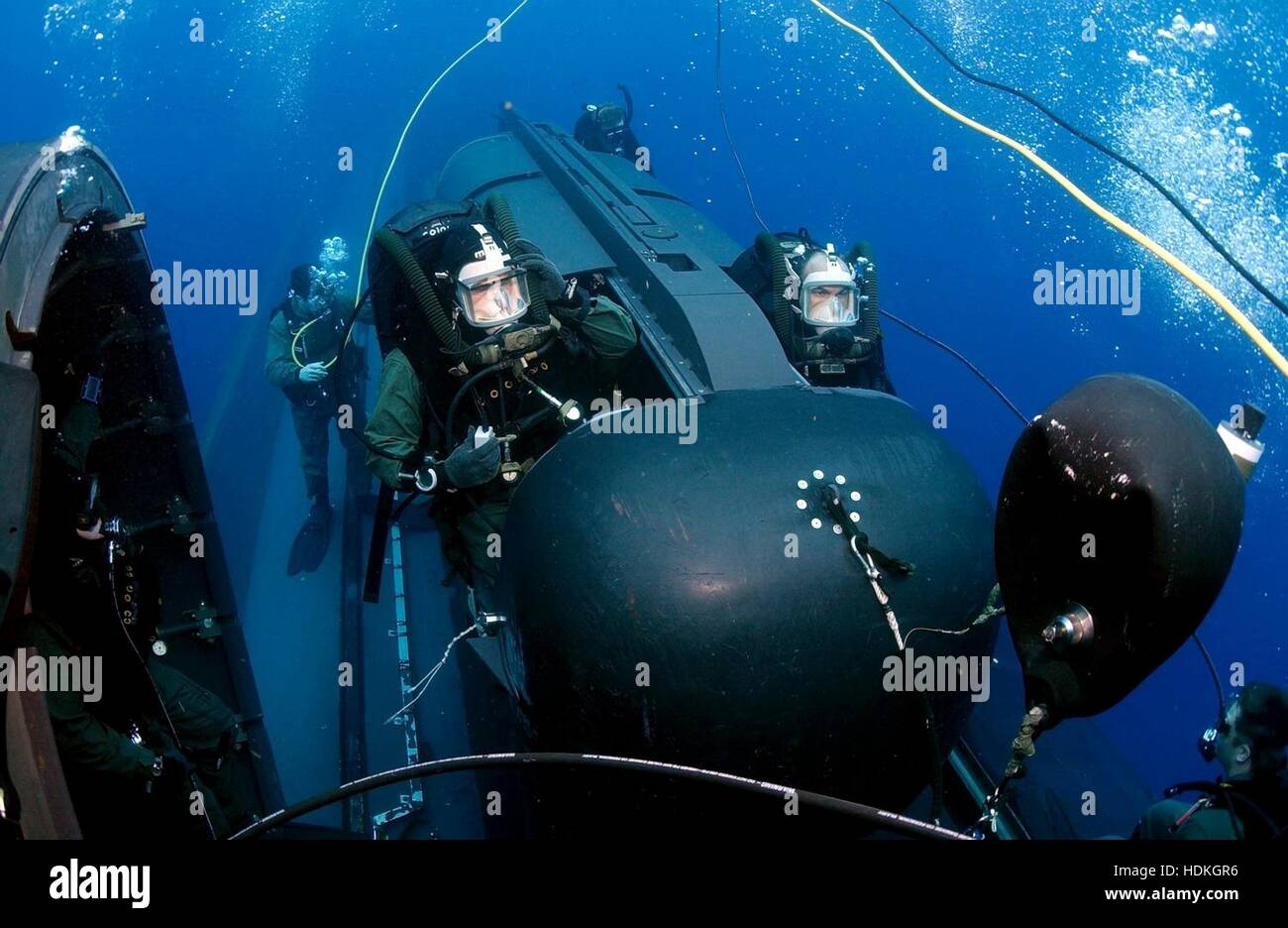 U.S. Navy SEAL divers prepare to launch a SEAL Delivery Vehicle from the back of the submerged USN Los Angeles-class - Stock Image