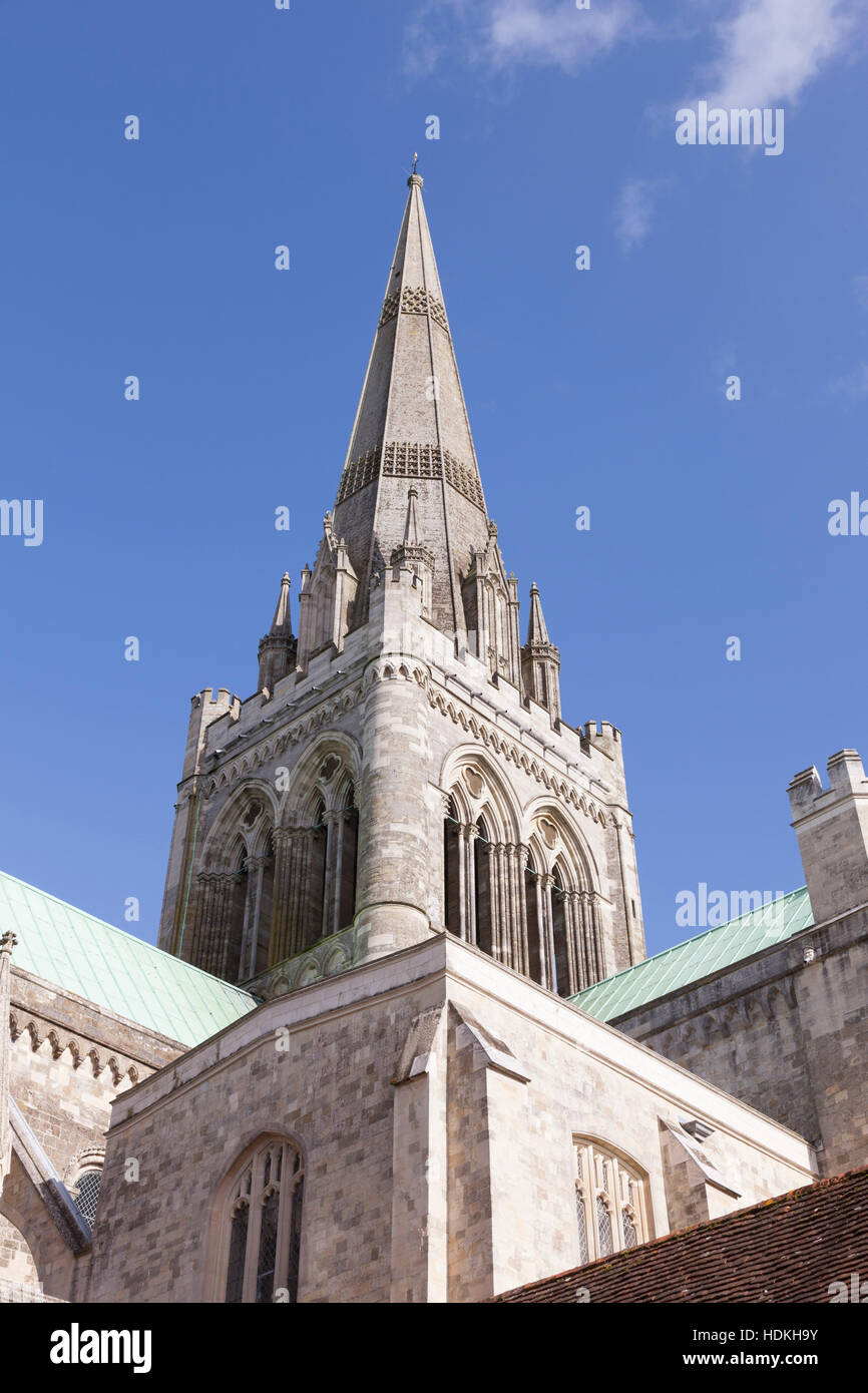 The spire of Chichester Cathedral in Sussex, against a blue sky. - Stock Image