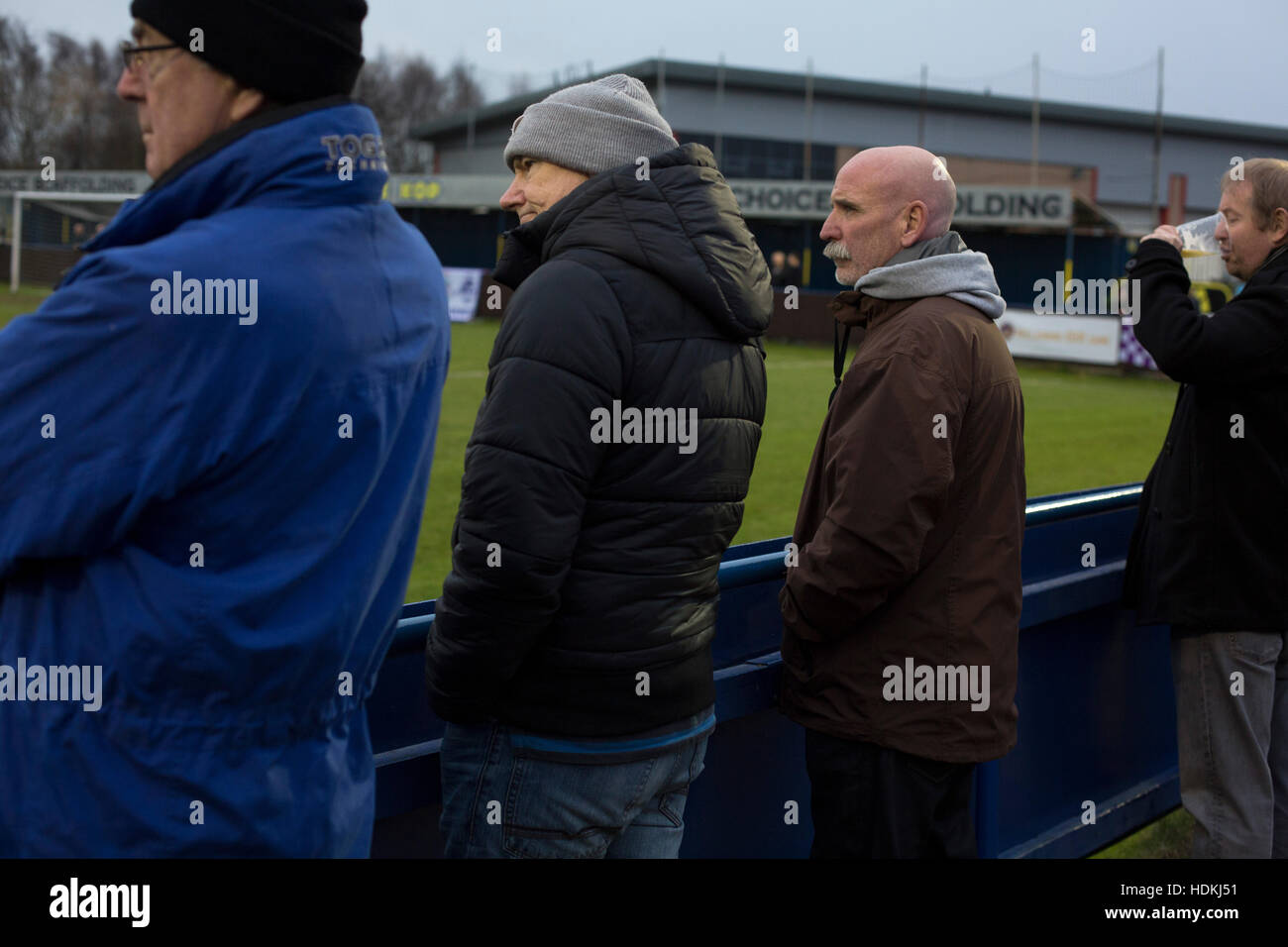 Home supporters watching the first-half action at the Delta Taxis Stadium, Bootle, Merseyside as City of Liverpool - Stock Image