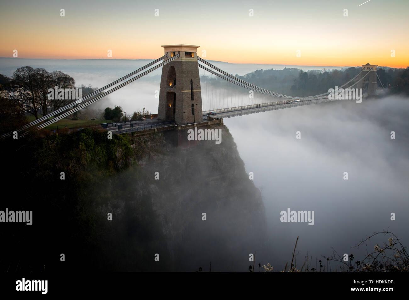 Clifton Suspension Bridge Bristol rising above inversion cloud in the Avon Gorge at dusk Stock Photo