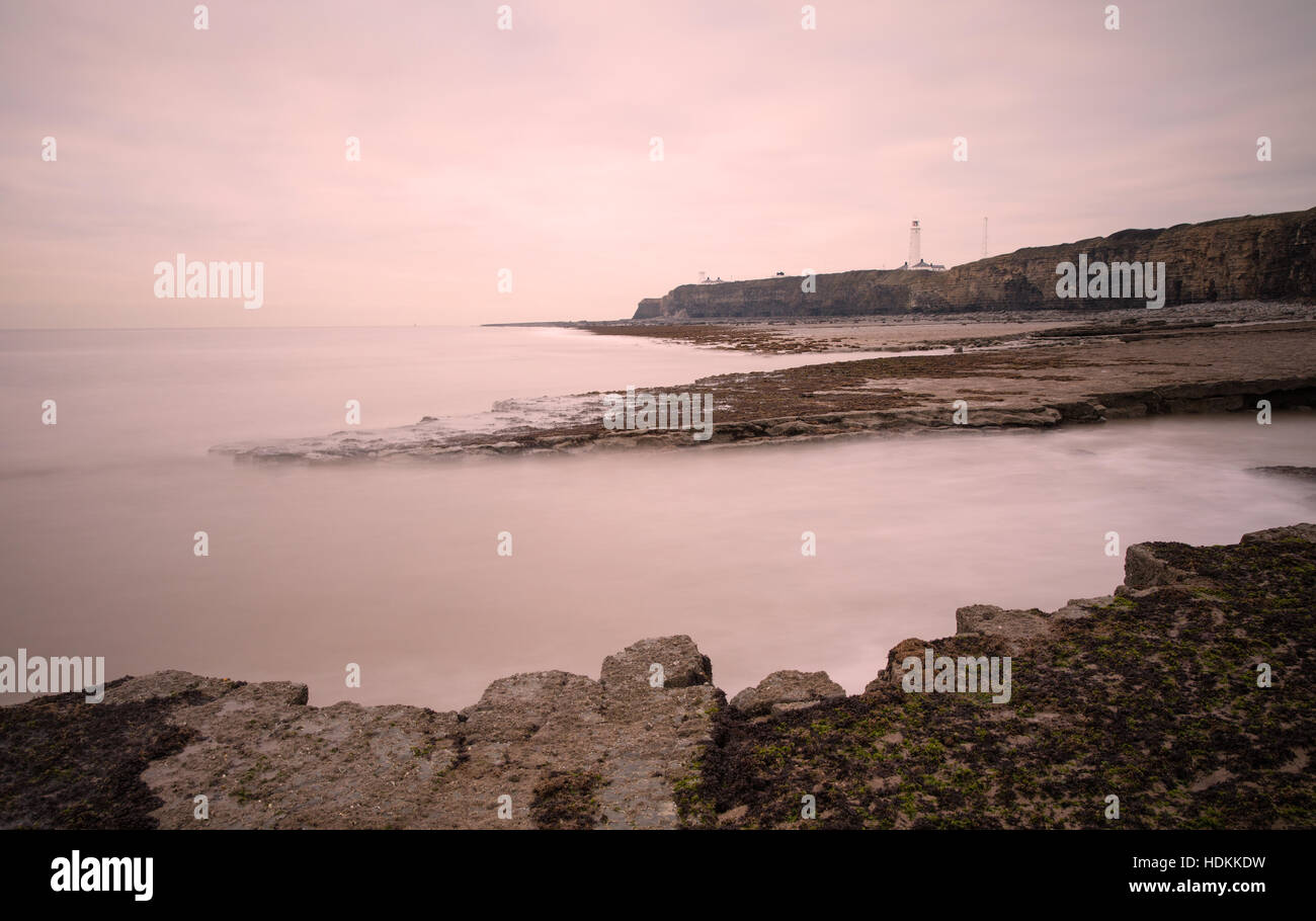 Lighthouse and cliffs at Nash Point on the Glamorgan Heritage Coast at dusk - Stock Image