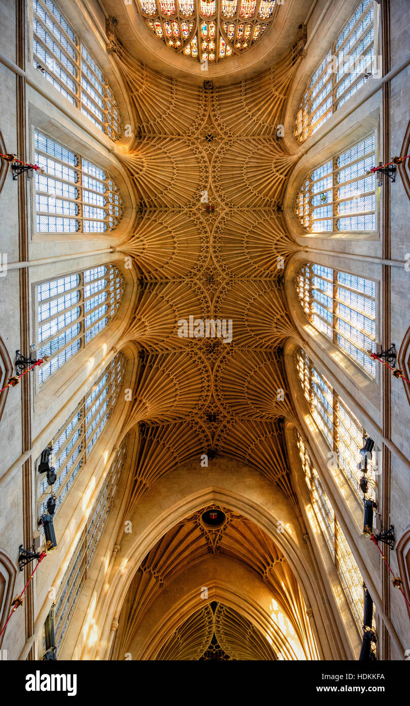 Delicate fan vaulting stone tracery and high lantern windows in the Gothic ceiling of Bath Abbey in Somerset UK - Stock Image