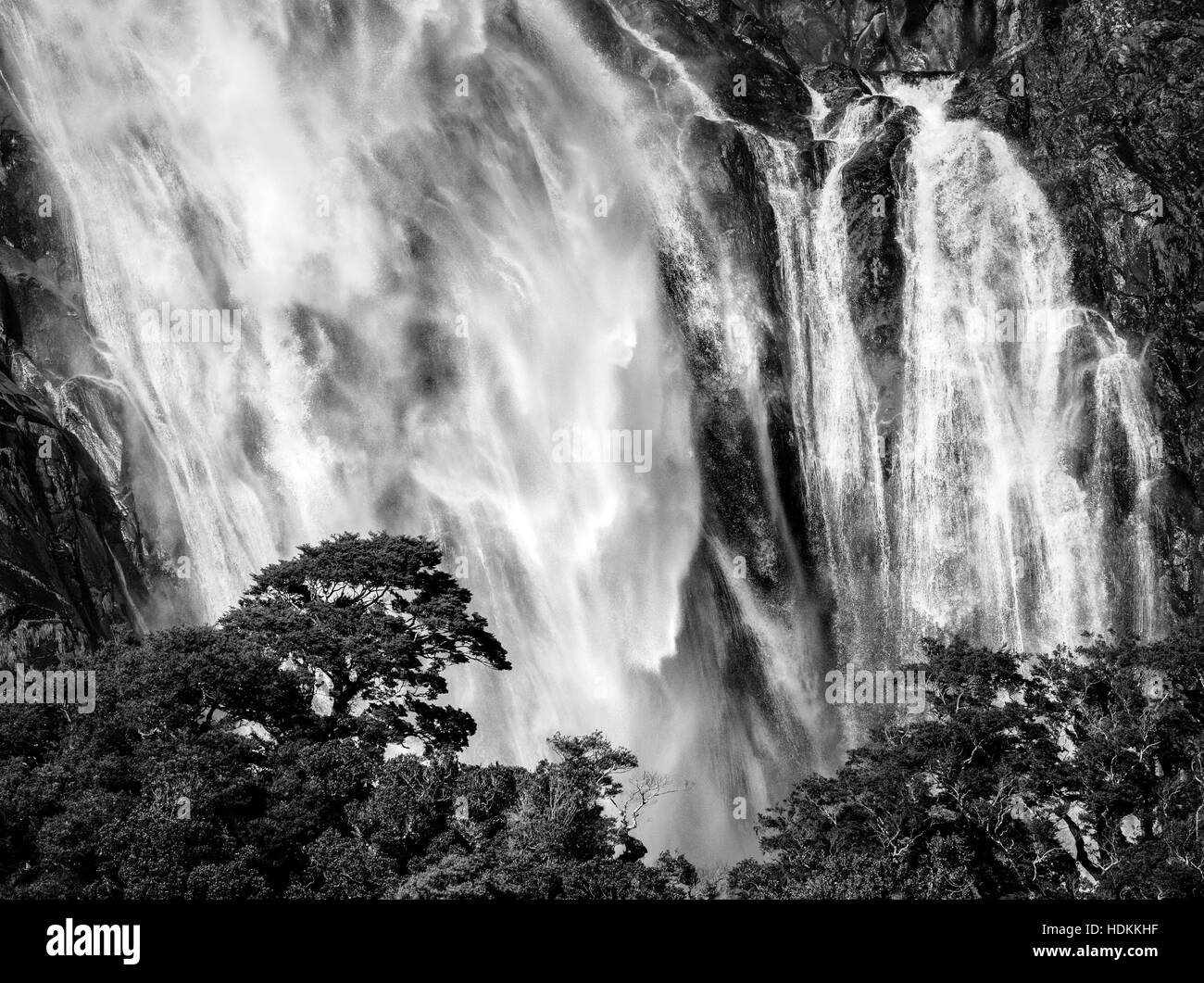 Lady Bowen Falls thundering into Milford Sound in Fjordland on South Island New Zealand - Stock Image