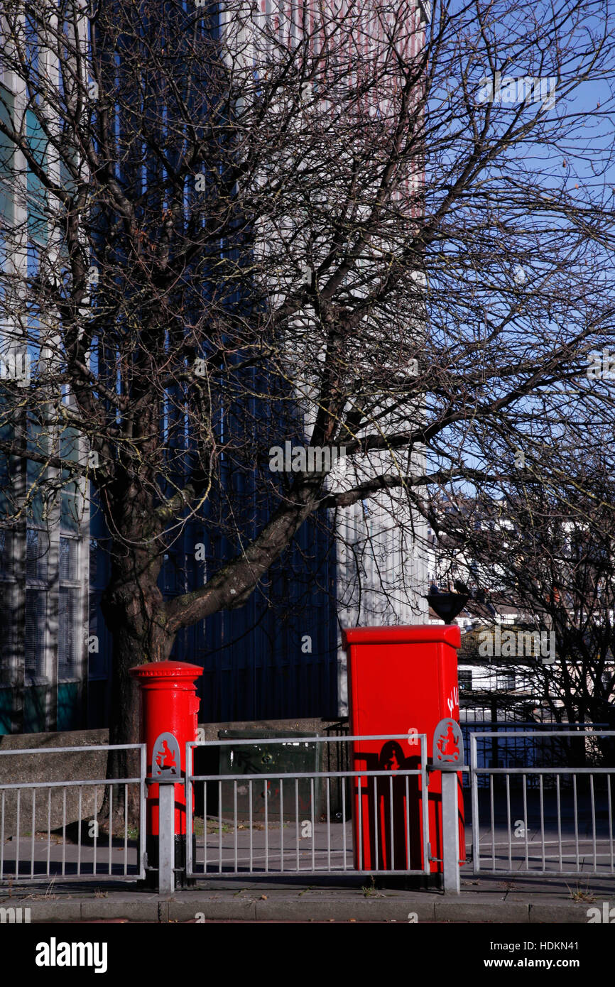 Red postboxes in a street - Stock Image