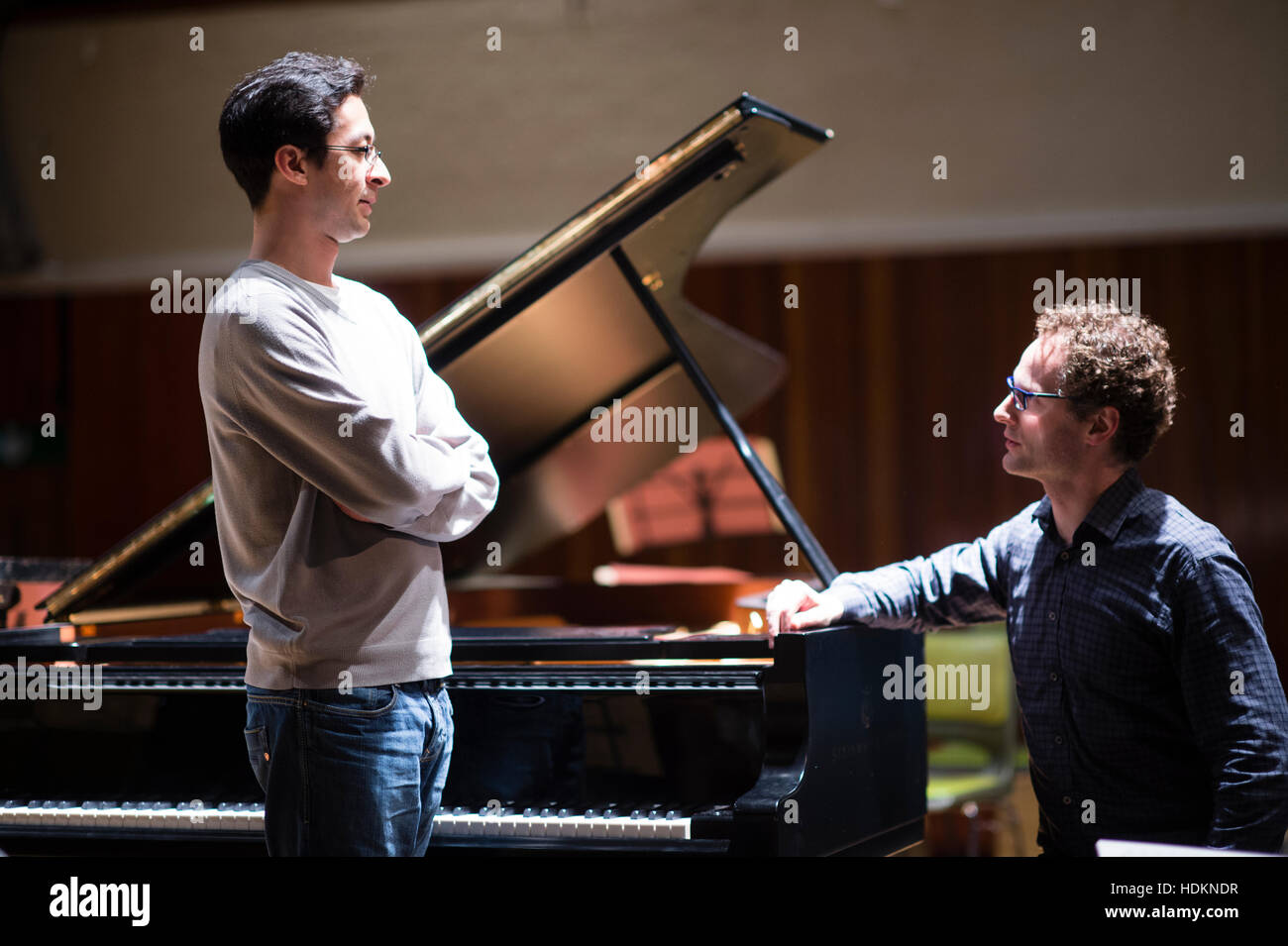 Toby Purser (conductor) and Tom Poster (piano - standing) at MusicFest Aberystwyth, Wales UK July 2016 - Stock Image