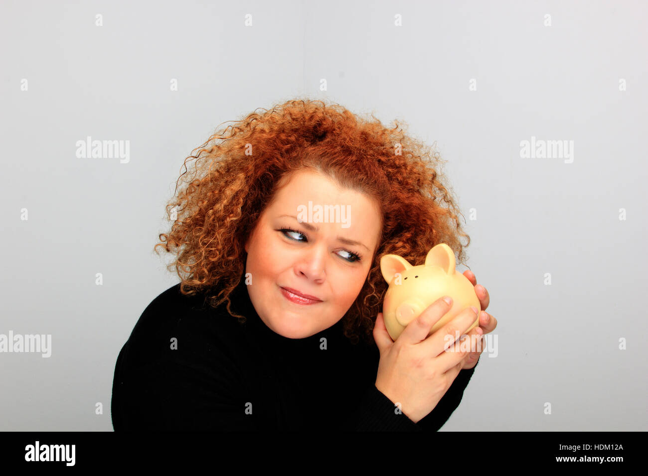 girl holding a piggy bank portrait Stock Photo