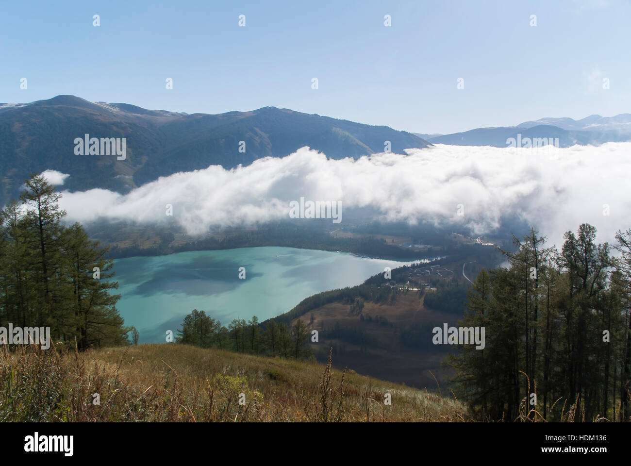 View of Emerald Lake Surrounded by Mountains - Kanas Region, China - Stock Image