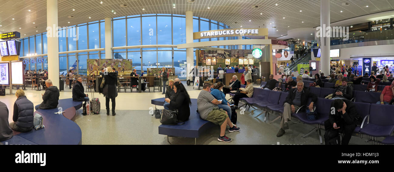 Manchester Airport Terminal One waiting and retail area,England, UK. Panorama - Stock Image