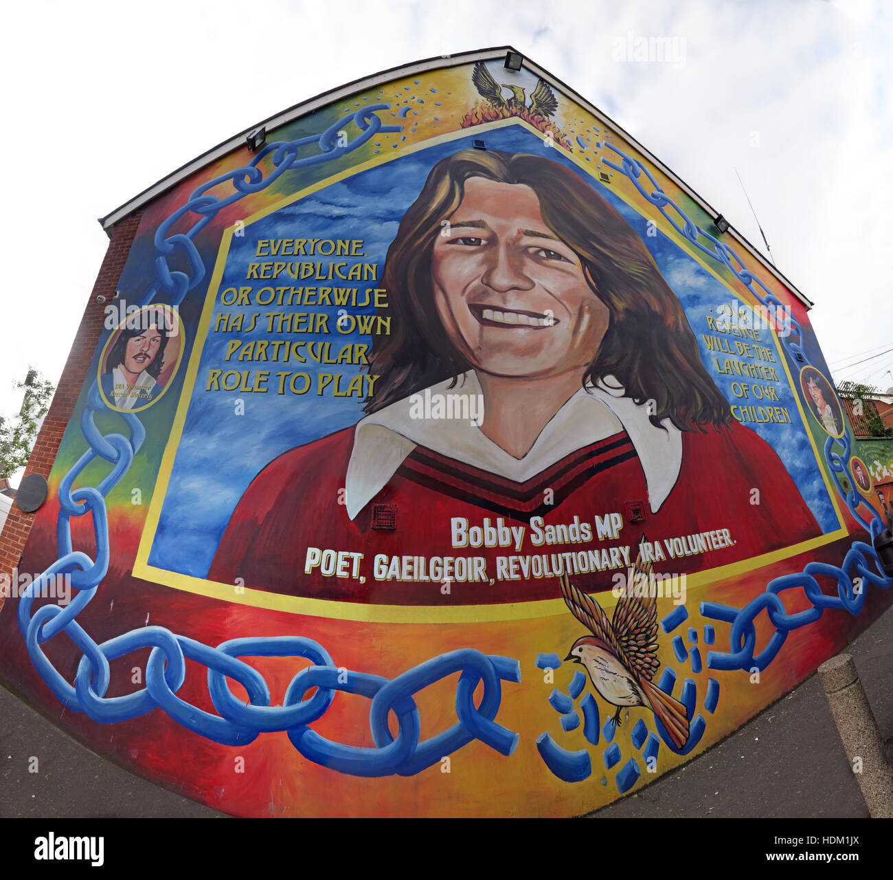 Belfast Falls Rd Republican Mural- Bobby Sands Poet,Revolutionary,IRA Volunteer on gable end wide angle - Stock Image